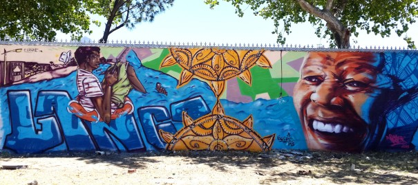 Langa Street Art Competition - Completed mural with artists Rayzer on your right and Love on your left